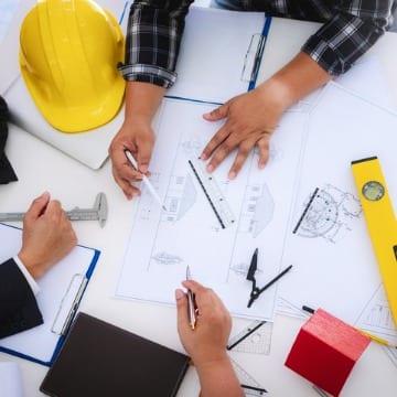 Construction Professionals Discussing Blueprints