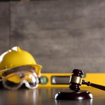 Safety Hat & Gavel On Desk